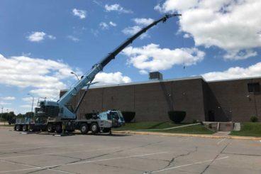 Grove TMS9000-2 truck-mounted crane in Lift-All Crane Service's distinctive blue