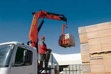 Palfinger Knuckle Boom Crane lifting wood