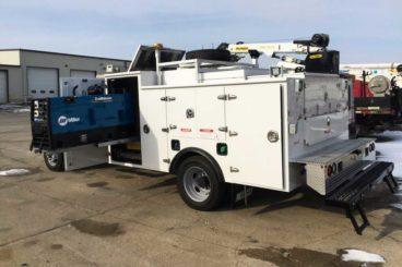 Palfinger Pal Pro railroad service truck with PSC 3215 crane and Miller welder