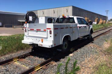 Purpose-built hirail signal maintainer service truck