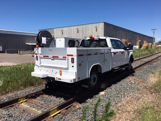 Purpose-built hi-rail signal maintainer service truck
