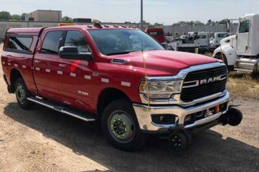 Ram 3500 Harsco Hyrail gear aluminum topper, slide-out bed and strobe