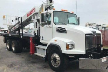 Purpose-built Western Star 4700, Elliott G85, 85 ft working height, 20 ft flatbed with storage