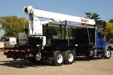 Mack bridge truck, Elliott 1870 crane, 36,000 lbs capacity, 70 ft reach, 16 ft flatbed with storage, DMF hi-rail, 5/10 GPM tool circuit, strobe and spot light package