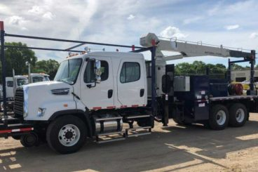 Freightliner 108SD bridge truck, National 671 crane, 20,000 lbs capacity, 37 ft reach, 18 ft flatbed with fall protection and storage, DMF hi-rail, 5/10 GPM tool circuit, strobe and spot light package
