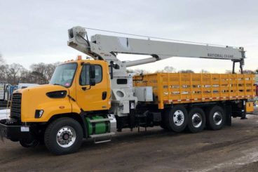 Freightliner 108SD, National NBT30 crane, 60,000 lbs capacity, 100 ft reach, 20 ft flatbed with storage, DMF hi-rail, 5/10 GPM tool circuit, strobe and spot light package