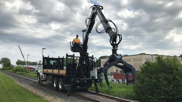 Railroad grapple truck with Aspen Creep Drive
