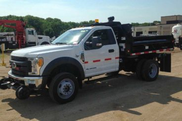 Purpose-built Ford F-550, Henderson 11 ft dump body, Harsco Hyrail, strobe and spot light package