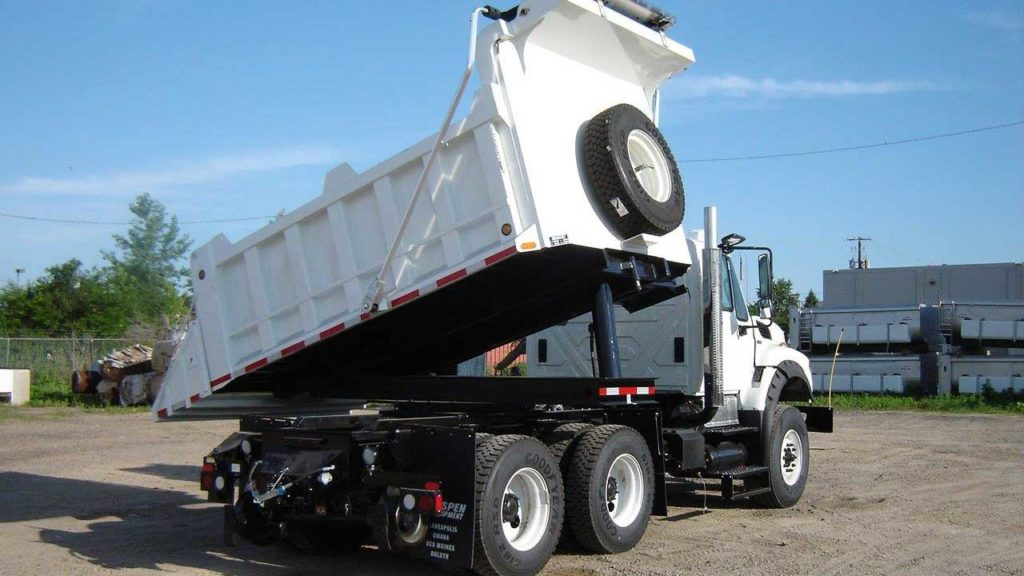 Purpose-built Freightliner 114SD, 14 ft rotating dump bed, DMF hi-rail, strobe and light package