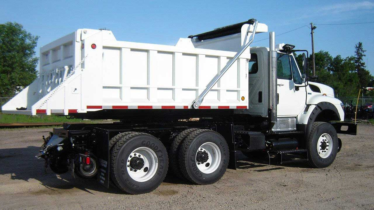 Freightliner 114SD, 14 ft rotating dump bed, DMF hi-rail, strobe and light package