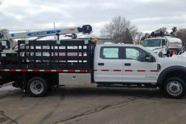 Purpose-built Ford F-550, 11' flatbed with tool boxes, Auto Crane 5005EH crane, 5,000 lb capacity, 16' reach, Harsco hi-rail