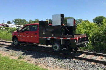 Purpose-built Ford F-550, 9' flatbed with storage boxes, 5/10 GPM tool circuit, Harsco hi-rail, strobe and spot light package