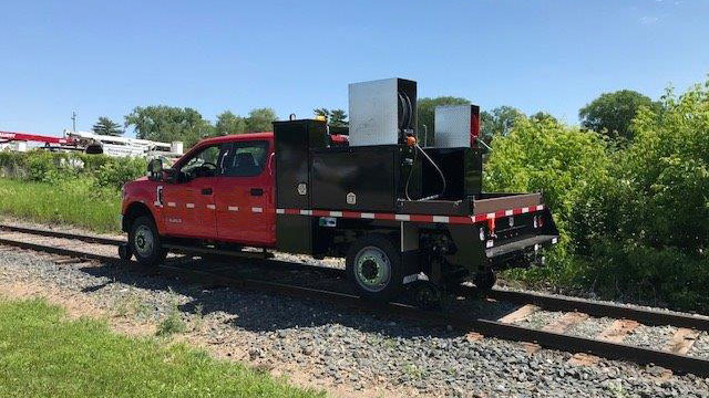 Purpose-built Freightliner 114SD, 20' flatbed with storage boxes, 2,000 lb Tommy Gate lift gate