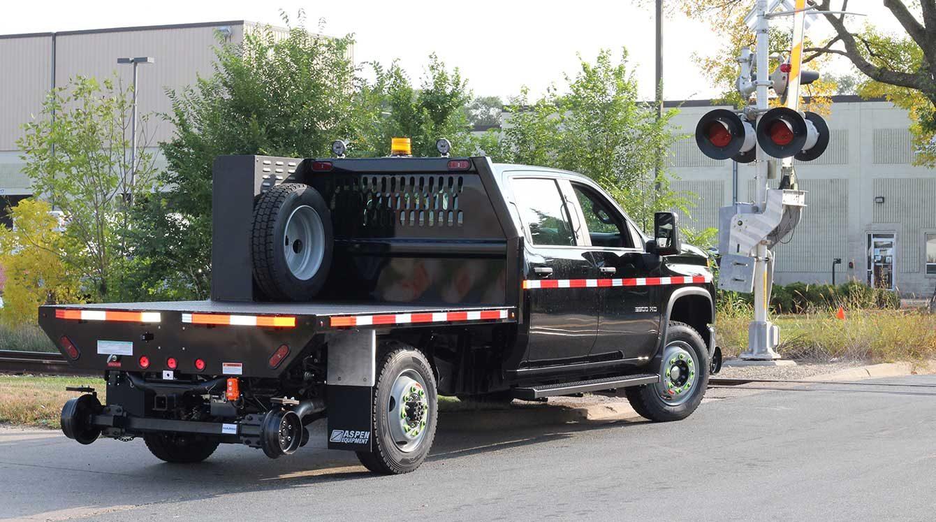 Purpose-built hyrail flatbed railroad truck