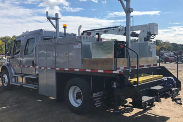 Freightliner M2-106, IMT 2020 crane 5,000 lbs capacity, 20 ft reach, 16 ft custom section body with storage and railracks, 5/10 GPM hydraulic tool circuit, DMF hi-rail, strobe and spotlight package