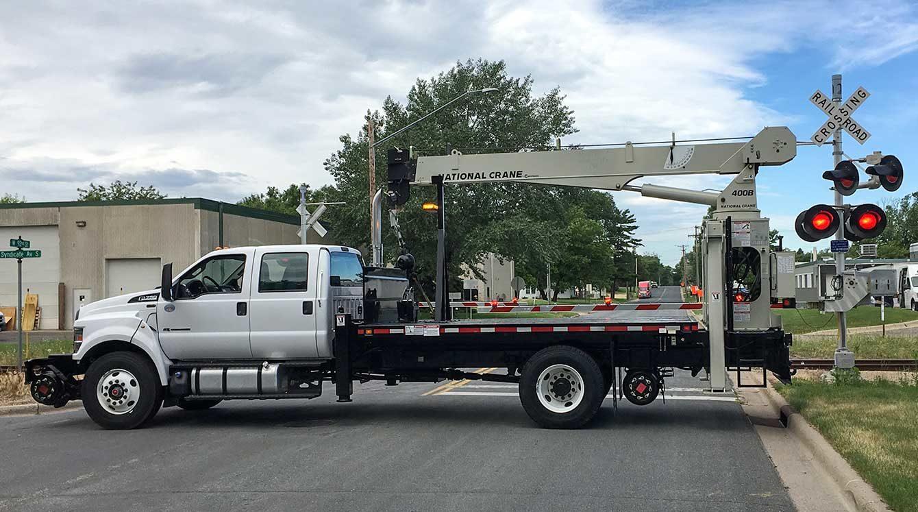 Ford F750 crew cab, National 437 crane, 20,000 lbs capacity, 37 ft reach, 14 ft flatbed, DMF 1630 Railgear