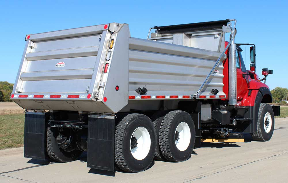 Henderson stainless steel MKE series dump body on tandem axle chassis