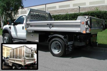 Henderson Mark III series stainless steel dump body with fold-down contractor sides. Optional wood chipper cover available.
