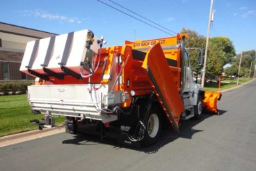 Axle snow plow truck with stainless steel body, plow, wing salt/sand spreader and pre-wet system