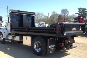 One of our Henderson 16 ft Mark-IV series dumping contractor landscape truck bodies with split fold-down sides