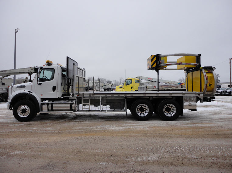 HD aluminum flatbed body with custom traffic cone storage and a safety traffic collision attenuator