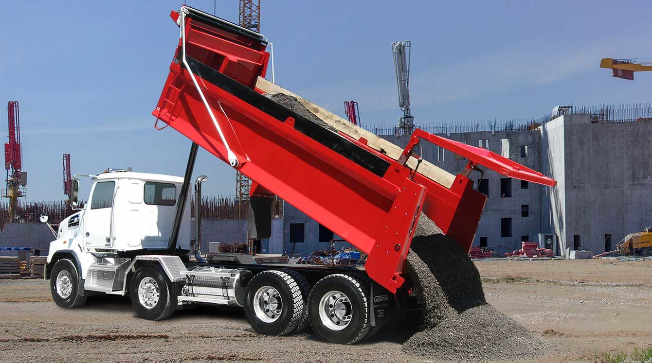 Bibeau BMT series dump body with Hi-Lift gate mounted on twin-steer chassis