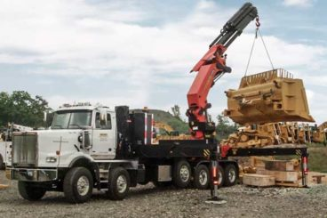 Equipment transport truck with Palfinger 100002 series crane - 43,870 lb max capacity