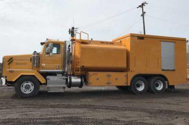 Tandem axle semi-enclosed lube truck with 3,000 gallon diesel fuel tank
