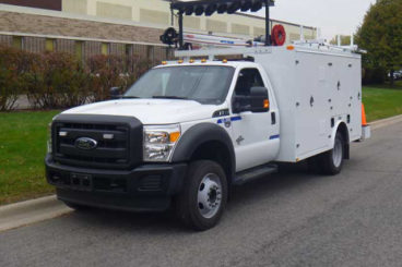 Custom sign body truck with service crane and traffic director
