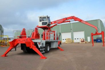 Cable reel handling truck with enclosed operator control cab