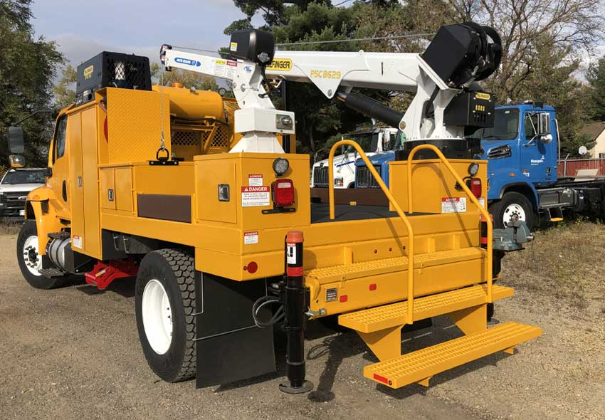 Specially built service truck with dual service cranes, air tools and a custom body