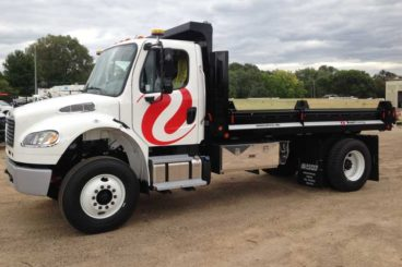 Henderson MKIV series dump truck body with split fold-down contractor sides