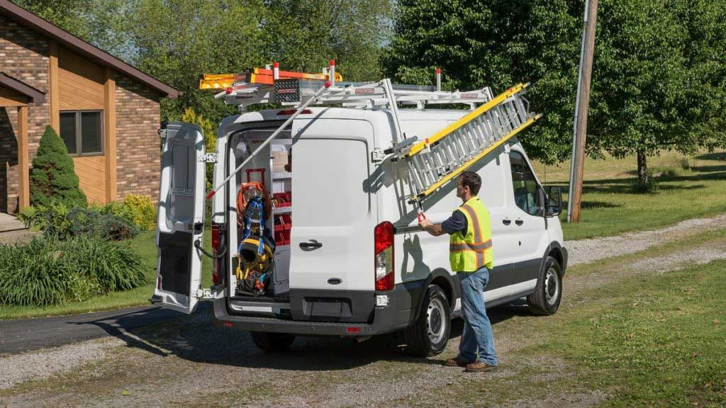 Van equipped with Weather Guard shelving and ergonomic van ladder rack carrier