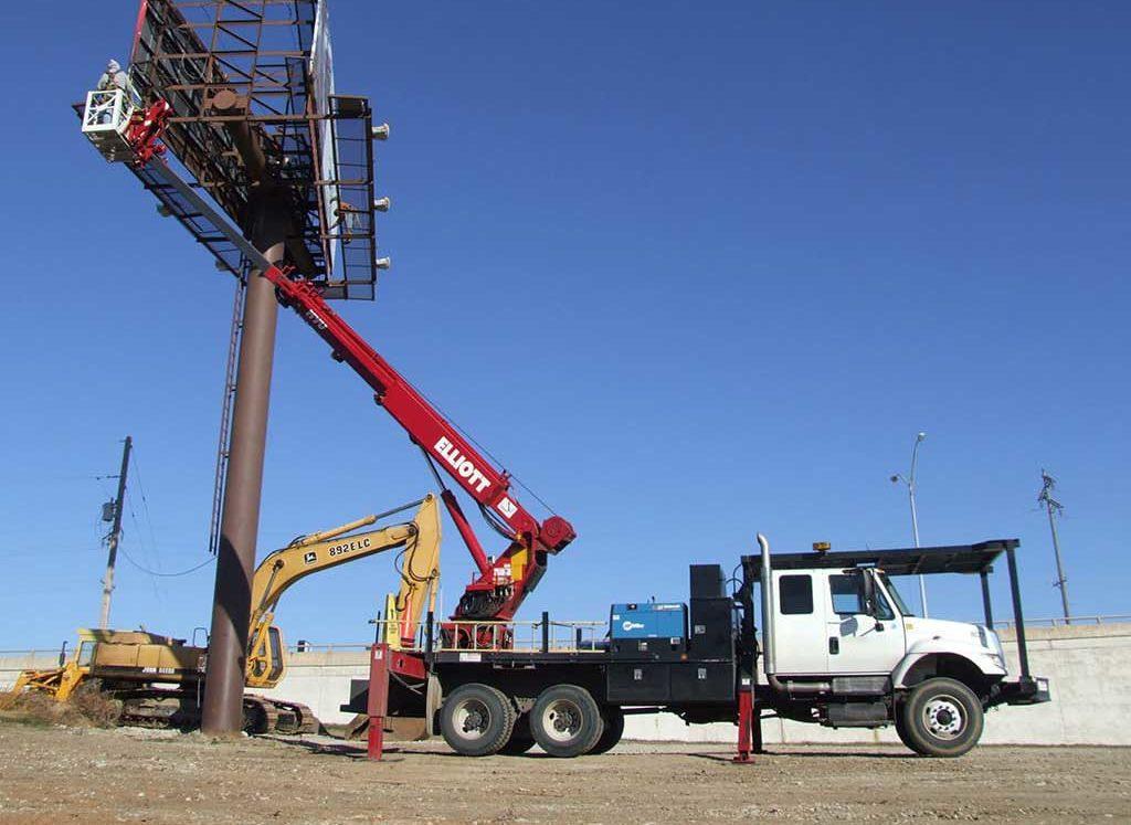 Elliott 90 ft aerial with rotating work platform, platform jib/winch and crane capabilities