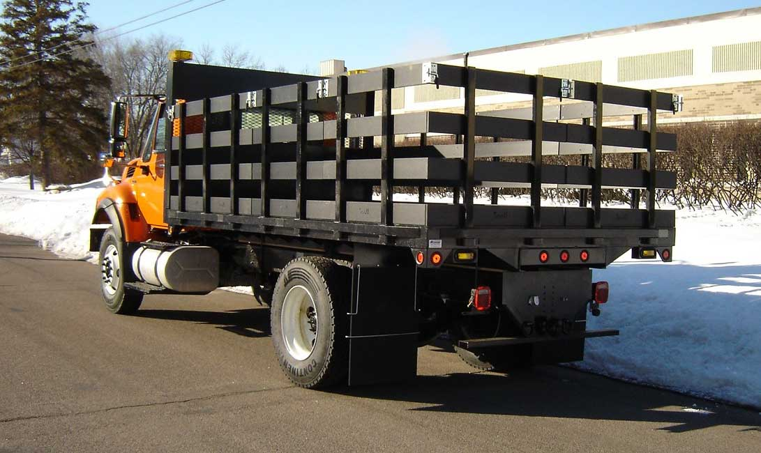 HD structural steel flatbed body with composite stake sides