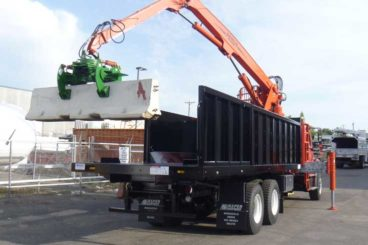 Serco 230B 23,000 lb capacity material loader with jersey barrier handling attachment