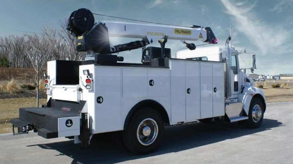 Palfinger PAL Pro model 86, 14 ft mechanics body with 14,000 lb capacity service crane and workbench bumper