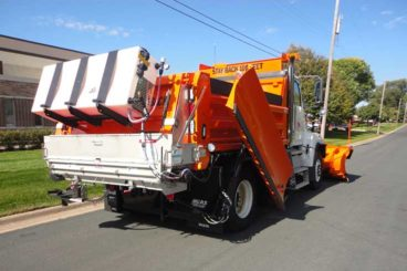 Snow plow truck with stainless steel body, plow, wing, salt/sand spreader, and pre-wet system