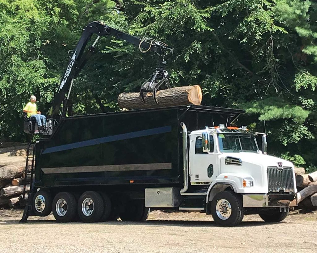 Serco 230B 23000 lbs capacity material loader with jersey barrier handling attachment