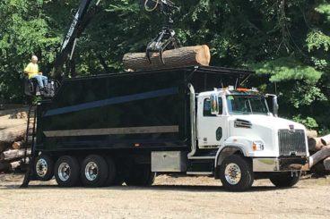 Serco log loader grapple truck