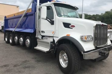 21 ft Bibeau BFL-S dump body mounted on a 2022 Peterbilt quint axle chassis