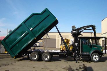 22 ft Aspen Equipment dumping tree truck body with Mailhot hoist and rear safety latched barn-doors