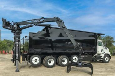 Western Star with a 22' Brandon tree body and a Serco 1050 grapple unit